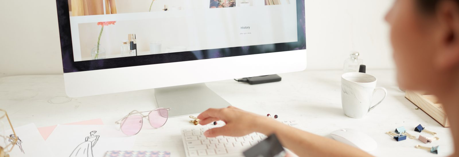 Close-up of woman sitting at table and buying clothing via online store using credit card, focus on computer screen payment security - buying clothing via online store SDZ3H9W 1600x550 - Payment Security